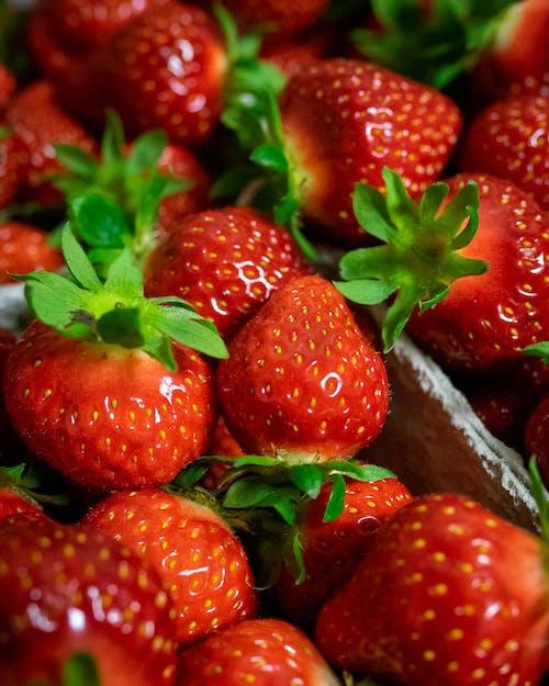 Red Strawberries in Brown Plastic Bag