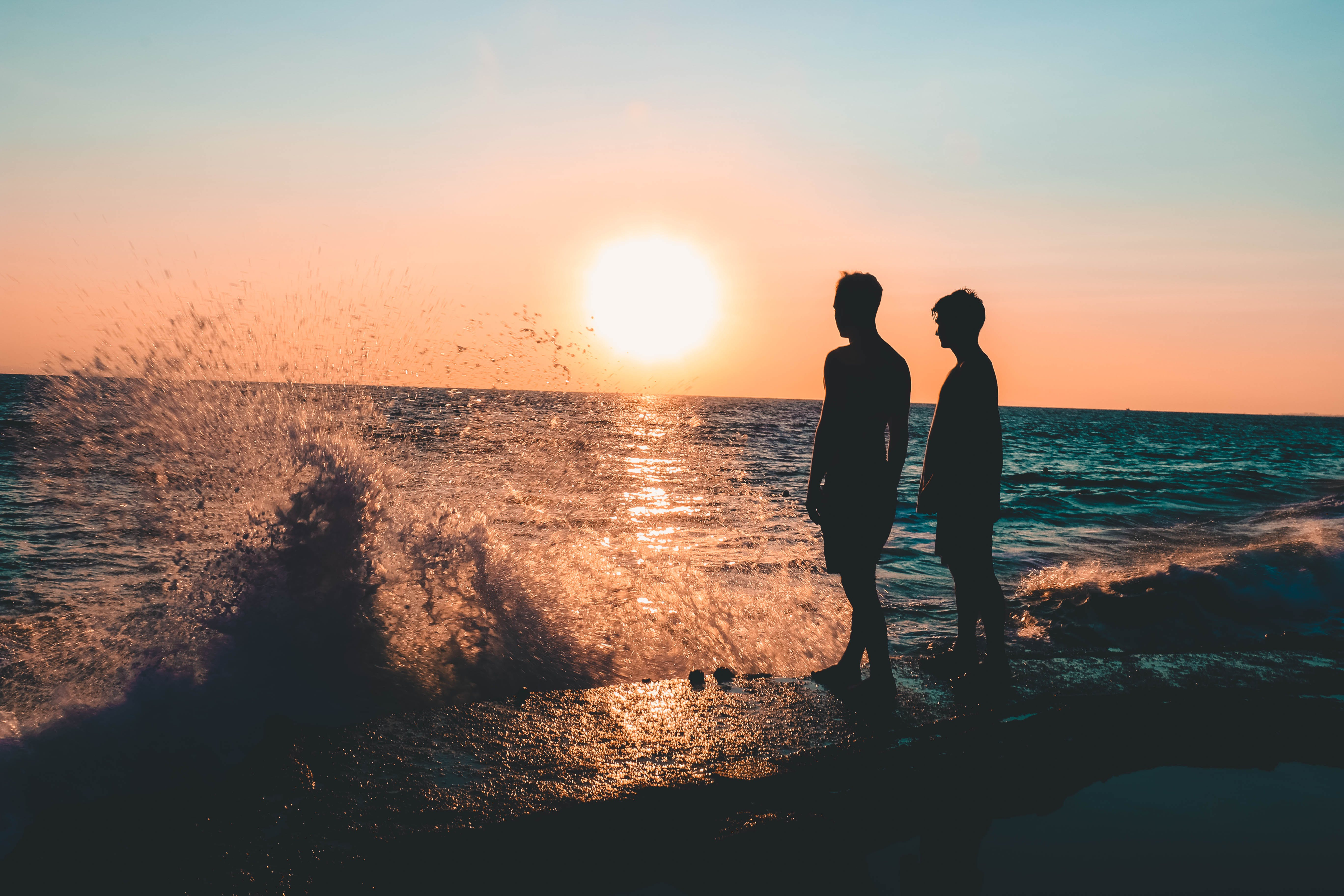 Two Men Standing on Seashore