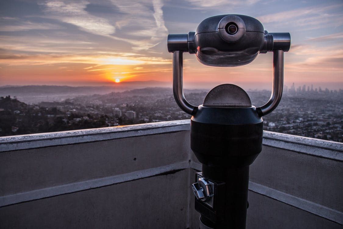 Coin-operated Tower Viewer on Rooftop during Sunset
