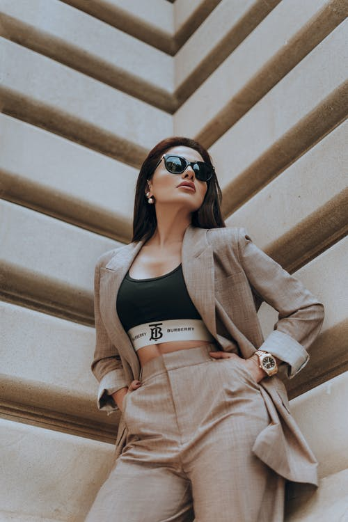 Low Angle Shot of Woman in Beige Suit