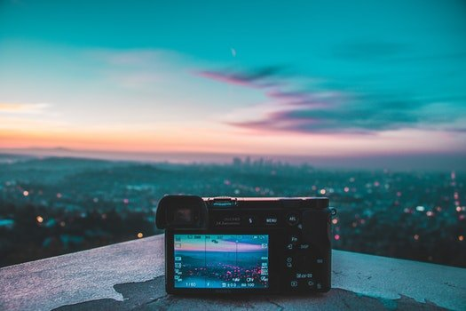 Camera Taking Picture of City