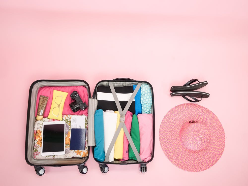 Pink and Black Backpack and White Smartphone