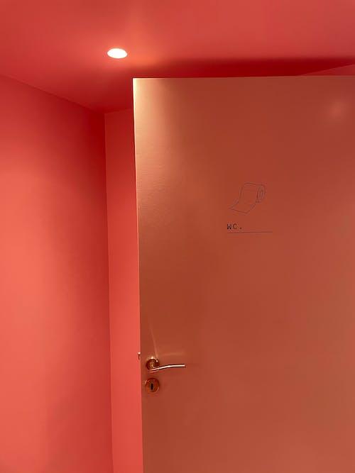 Silver Door Lever on Pink Wooden Door