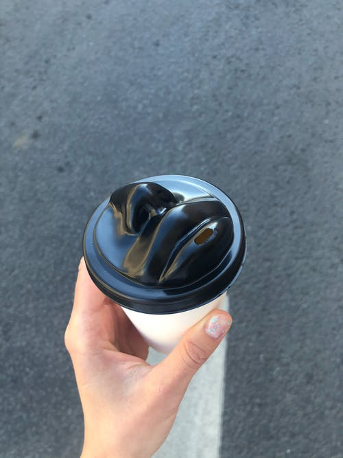 Person Holding White and Black Cup