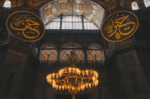 Gold and Black Chandelier on Ceiling