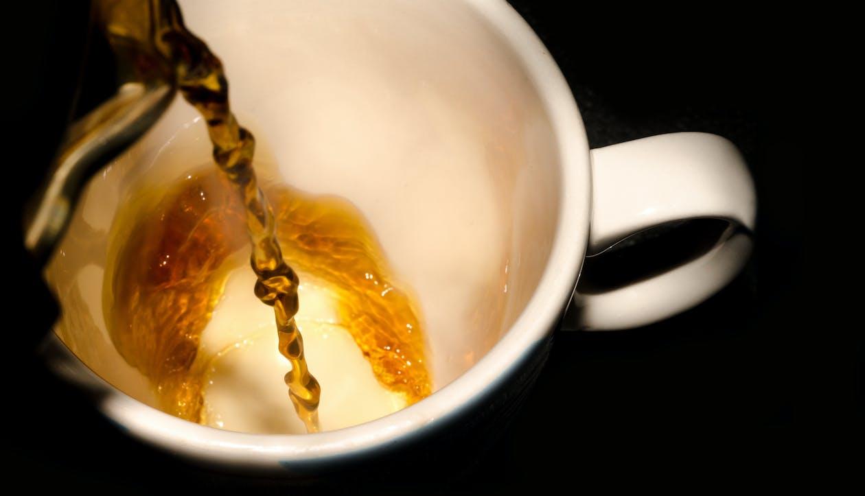 Tea Poured in White Ceramic Cup