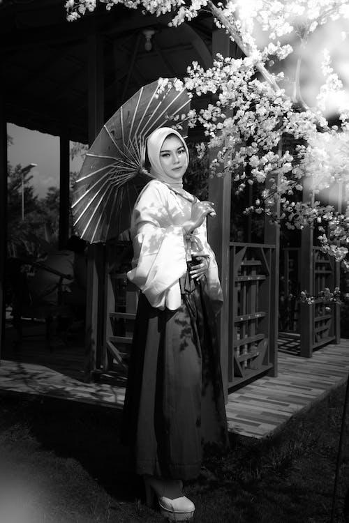 Grayscale Photo of Woman in Kimono Holding Umbrella