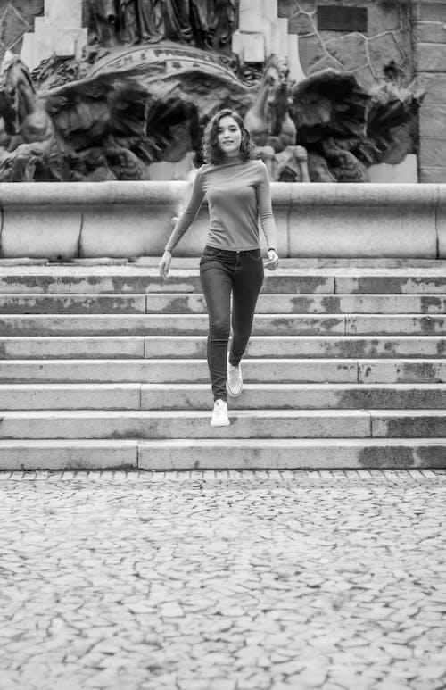 A Woman Walking Down the Steps