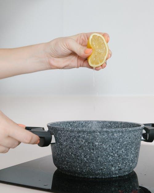 A Person Squeezing a Lemon