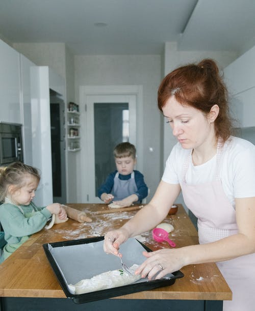 Woman Cooking with the Kids