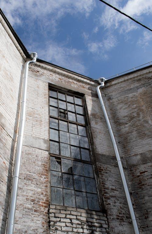 Brown Brick Building Under Blue Sky