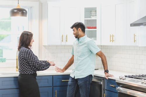 A Realtor Talking to a Client