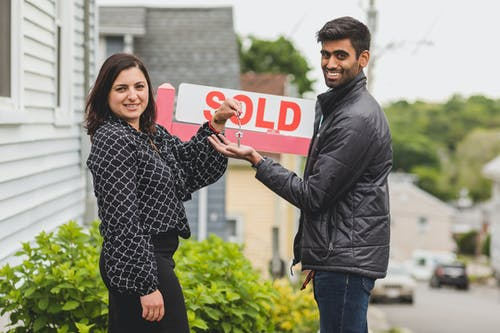 Real Estate Agent Handing the Key to Her Client