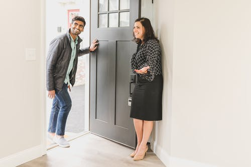 Real Estate Agent Showing the Unit to Her Client