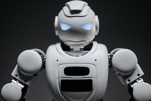 Close Up Shot of White Robot Toy