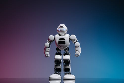 Toy Robot in Pink and Blue Background