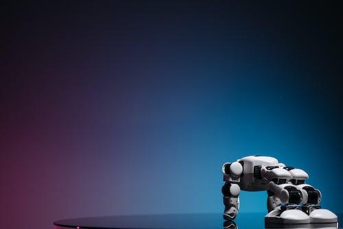 White Toy Robot on Blue Background