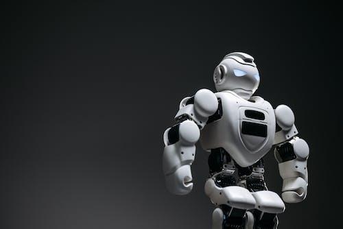Close Up Shot of White Toy Robot