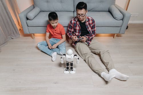 A Father Controlling a Robot with His Cellphone