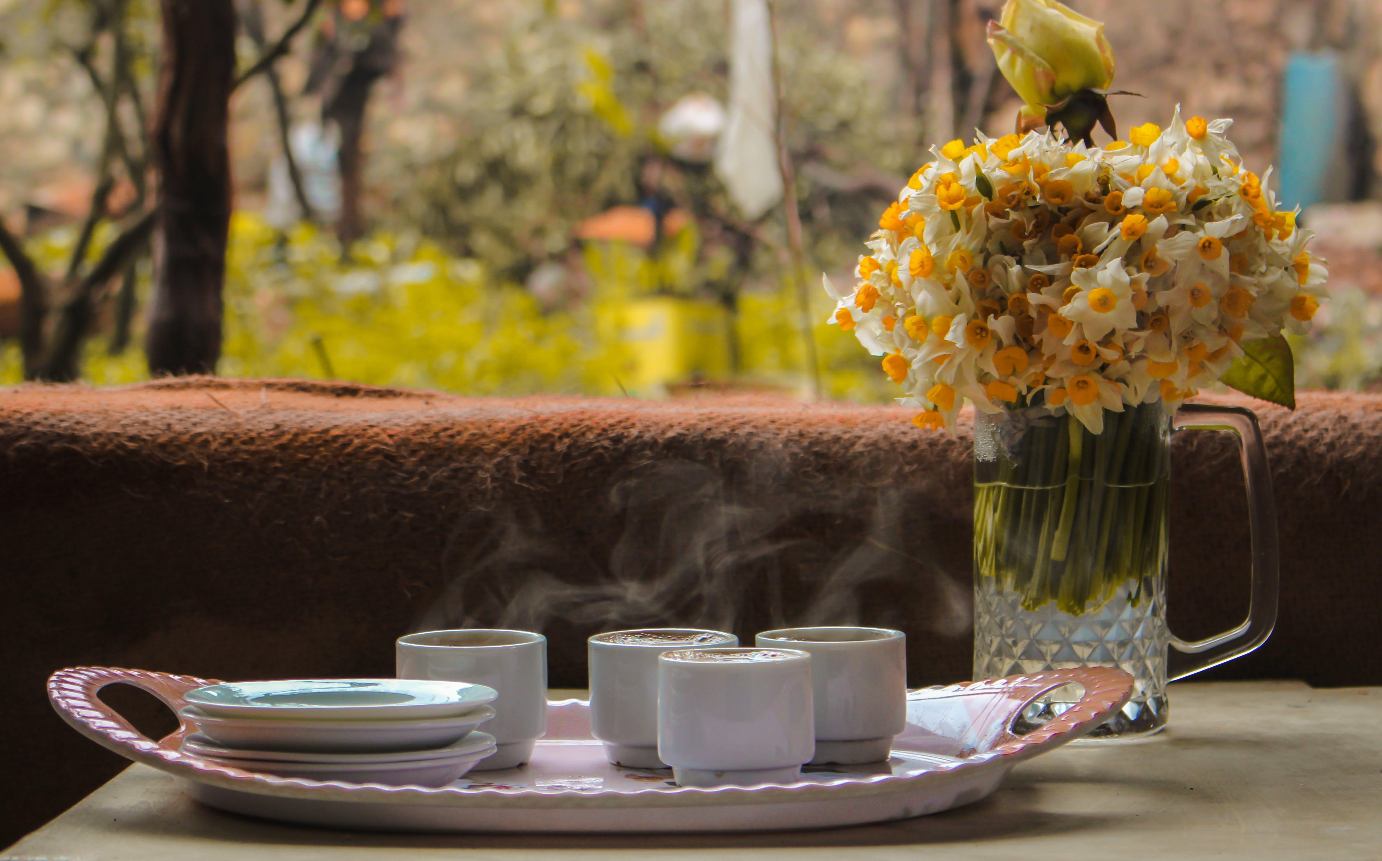 Free stock photo of artificial flowers, beautiful flowers, black coffee, coffee