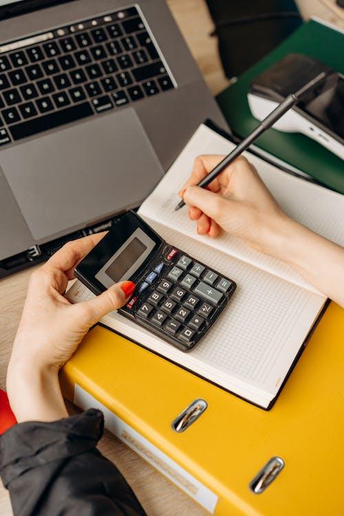 A Person Using Calculator