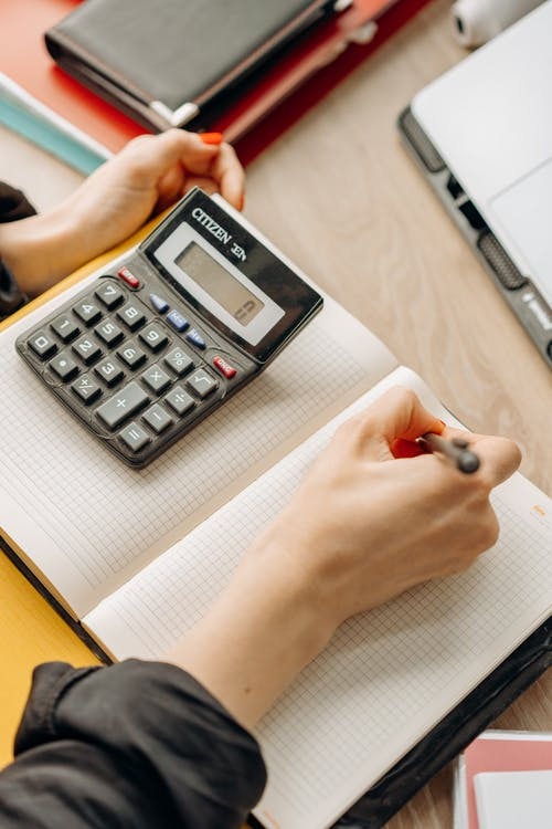 A Woman Computing with a Calculator