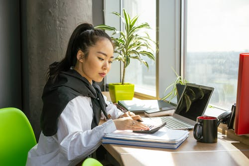 A Woman Working in the Office