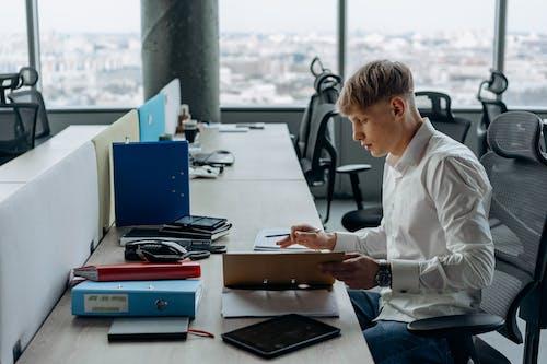 A Man Working Inside an Office