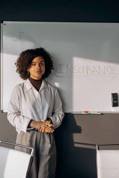 A Woman Making a Presentation on the Whiteboard