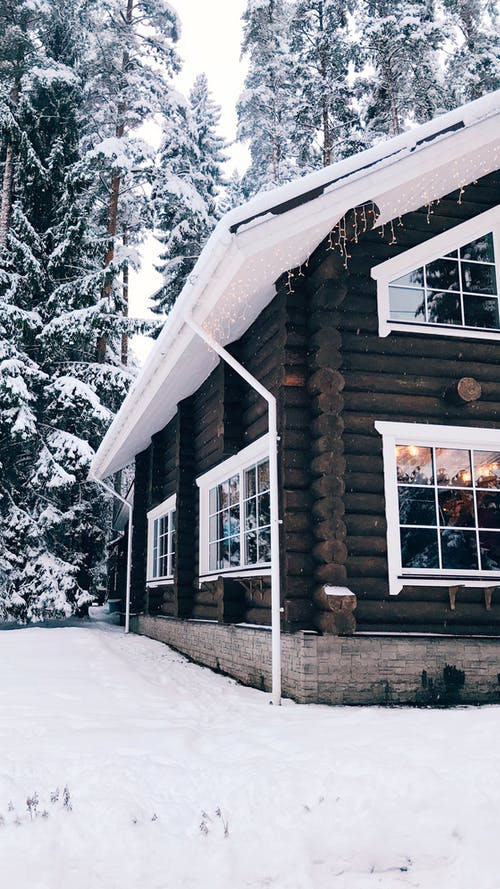 Wooden Cabin Surrounded with Snow