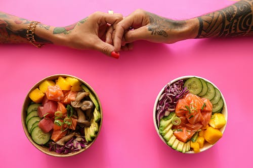 Sliced Fruits in Bowl on Pink Table