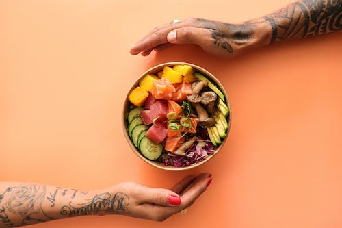 Person Holding Bowl of Fruits