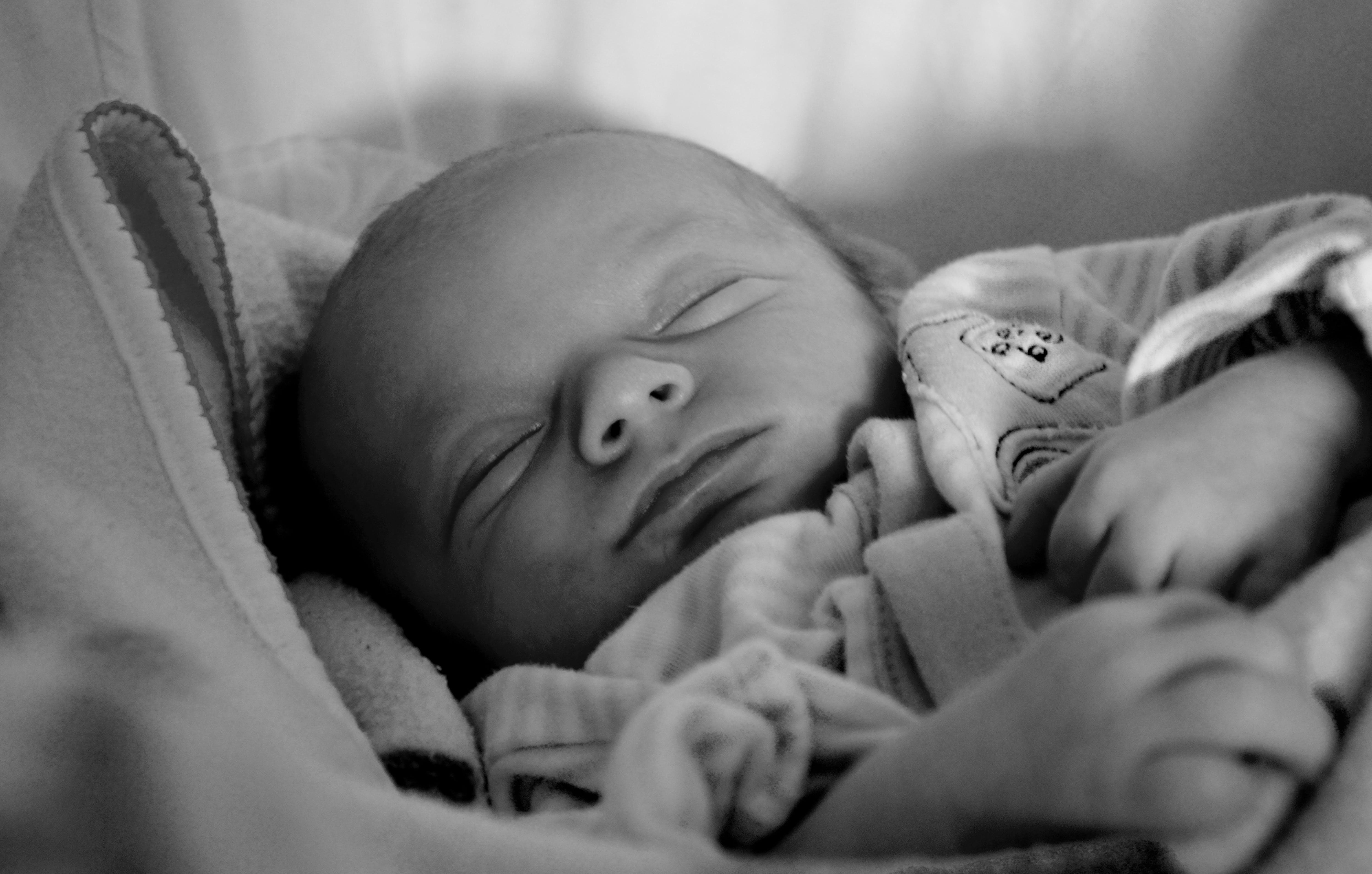 Grayscale Photography of Baby Sleeping
