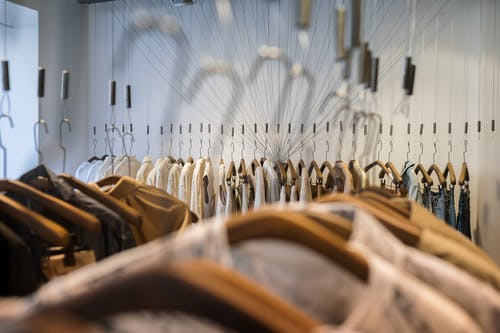 Brown and Black Clothes Hanged on Clothes Hanger