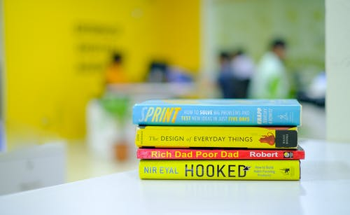 Selective Focus Photography of Books on Table