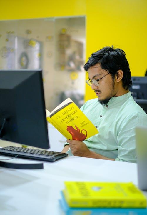 Man in White Dress Shirt Holding Yellow Box