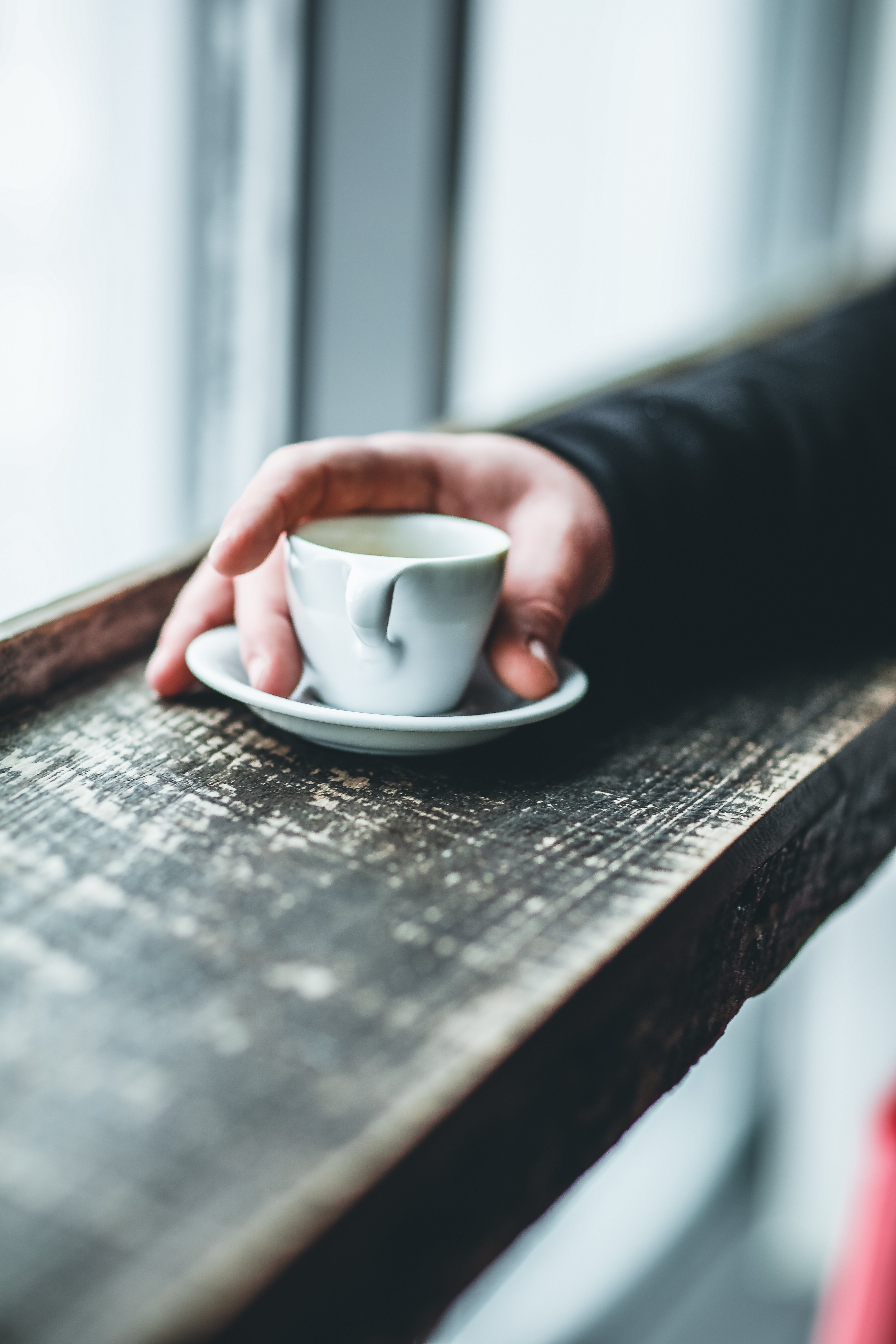 Person Holding White Teacup
