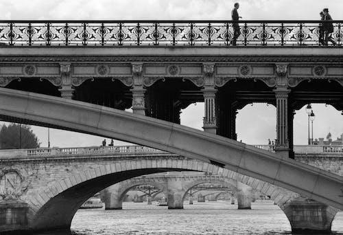 Grayscale Photo of Bridge over Body of Water