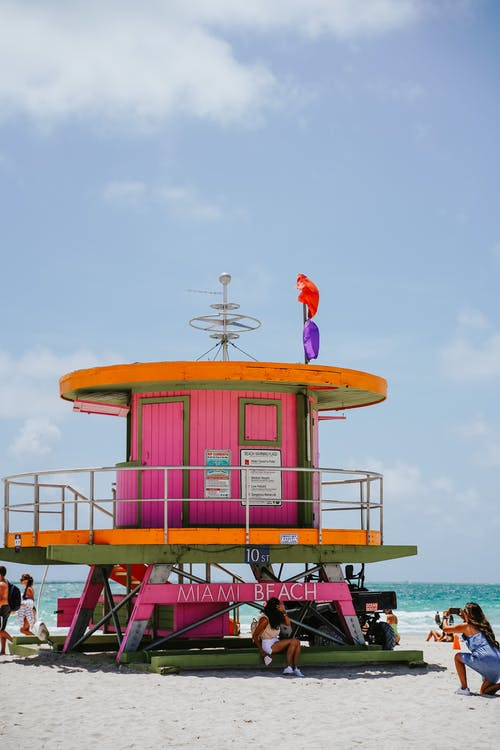 Red and White Lifeguard Tower on Beach