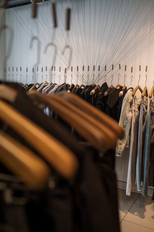 Black and Brown Clothes Hanged on Clothes Hanger