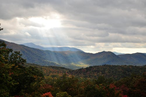 Free stock photo of back light, blue mountains, cloudy skies