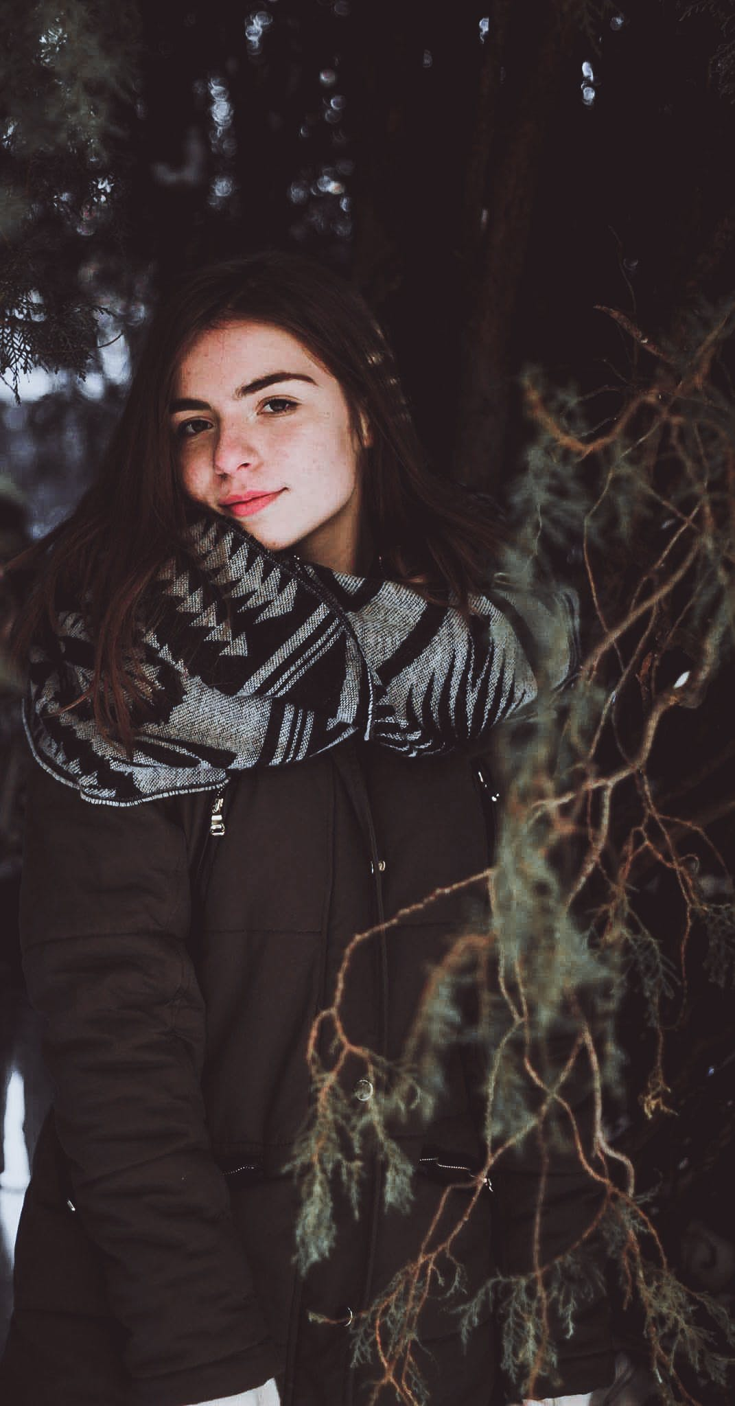 Woman Wearing Black Zip-up Jacket Posing Under Tree