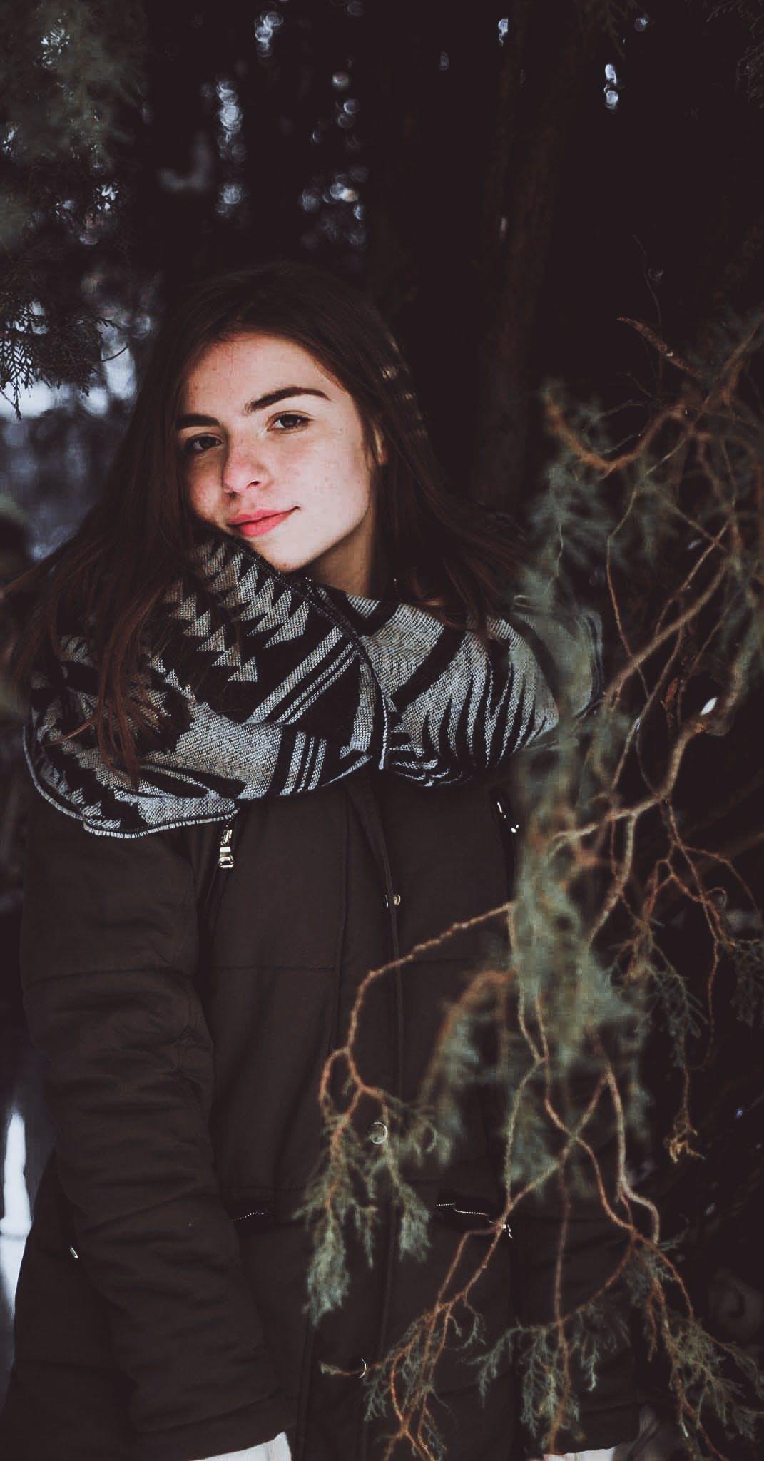 Woman Wearing Black Zip-up Jacket Posing Under Tree