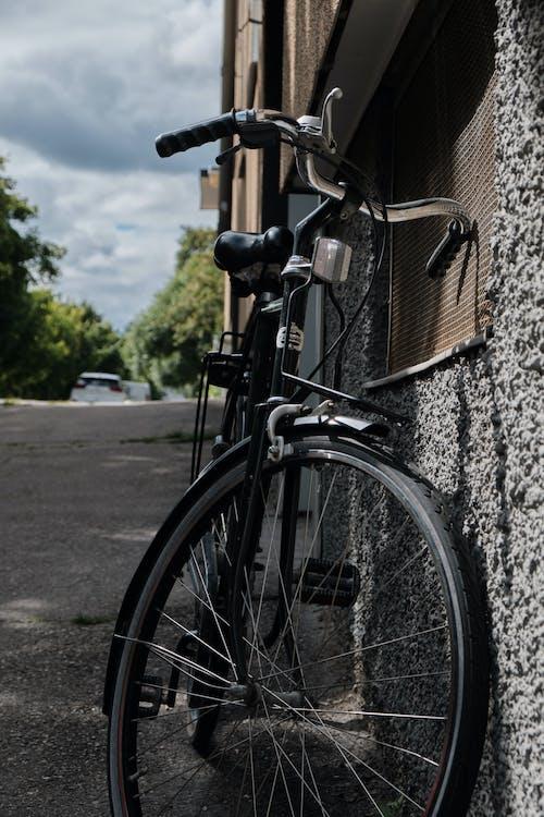 Black City Bike Leaning on Wall