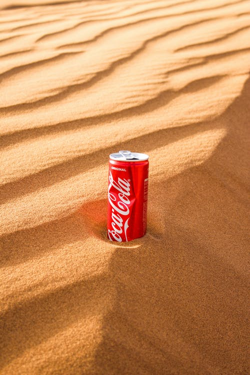 Coca Cola Can on Brown Textile