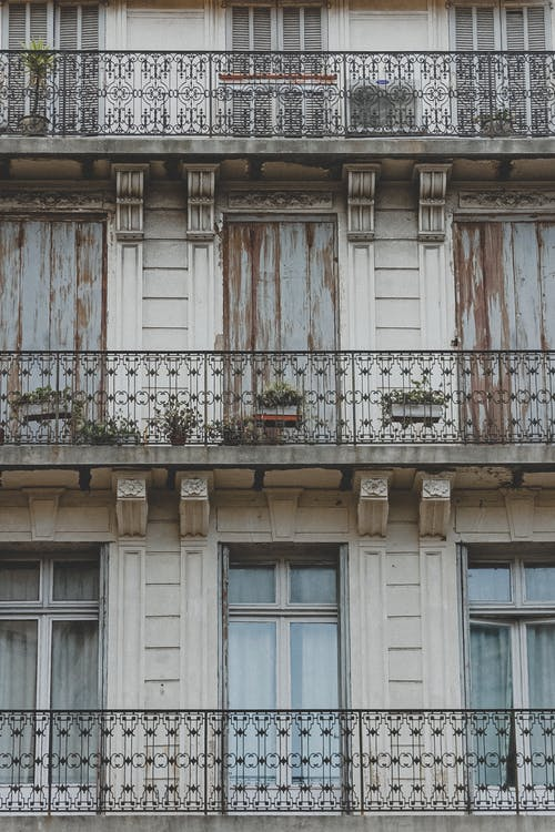 Facade of old residential building with balconies