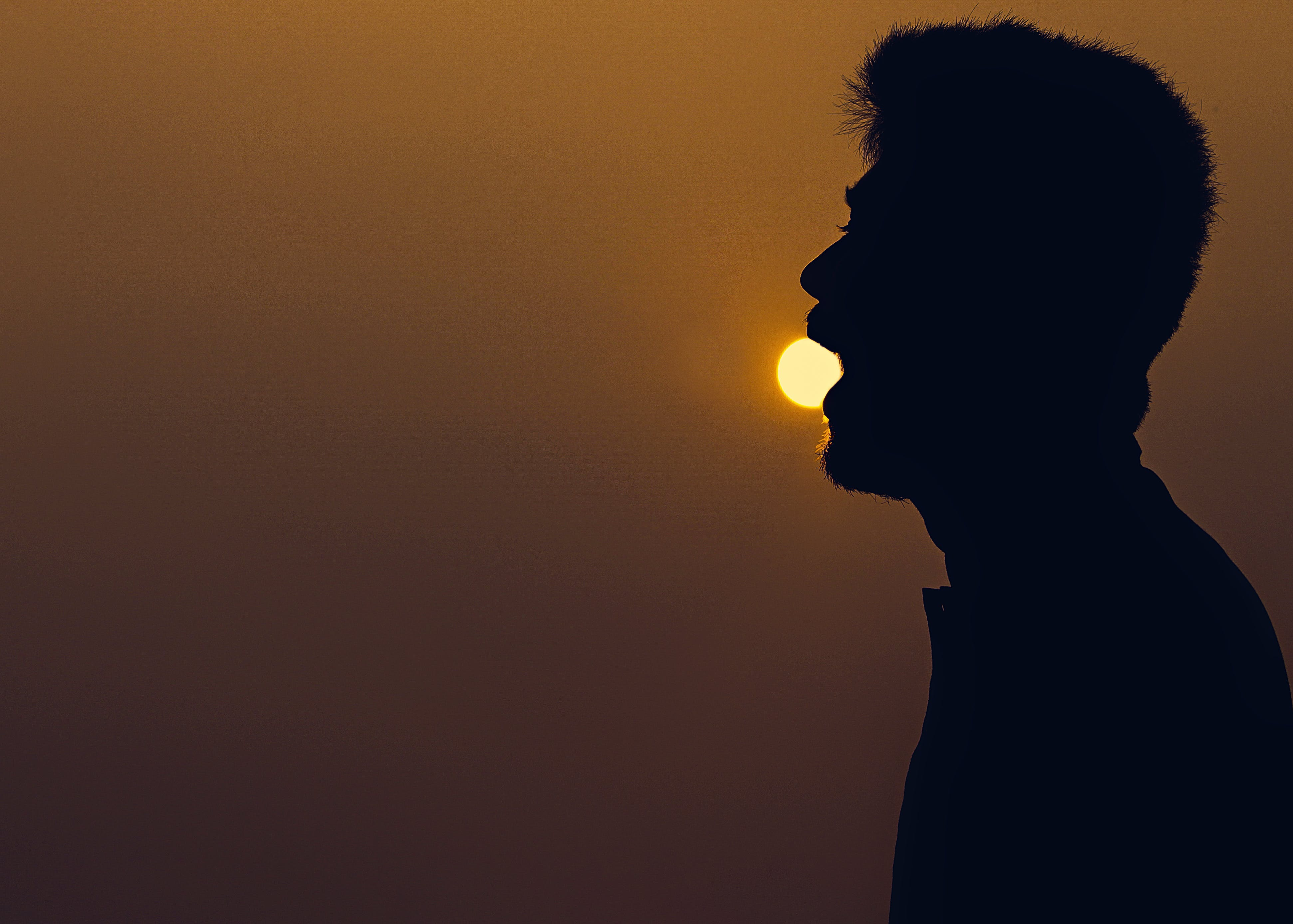 Silhouette of Man over the Horizon