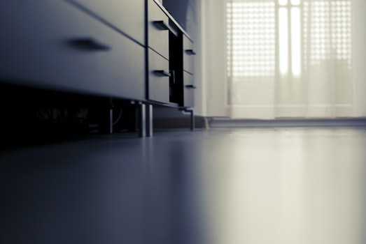 Black Cabinet Near White Curtain