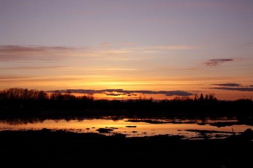 Darmowe zdjęcie z galerii z estonia, powódź, zachód słońca