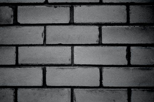 Darmowe zdjęcie z galerii z ceglana ściana, czarno-biały
